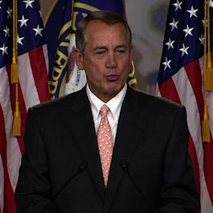 John Boehner blows kisses at a reporter
