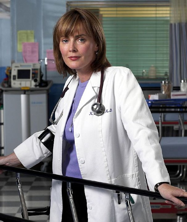 Laura Innes as Dr. Kerry Weaver  in ER on NBC. 