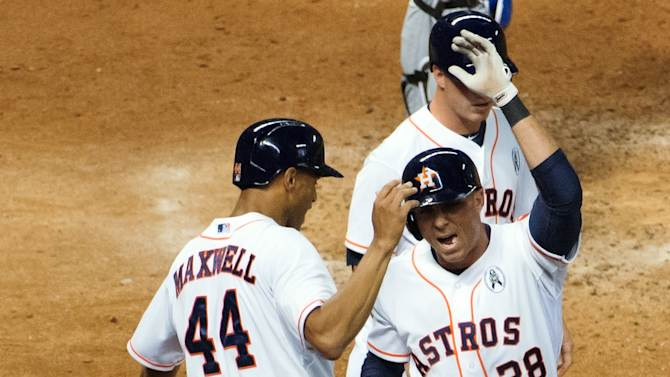 Houston Astros pinch hitter Rick Ankeil (28) celebrates with Justin Maxwell (44) after hitting a three-run home run against the Texas Rangers during the sixth inning of a season-opening baseball game at Minute Maid Park, Sunday, March 31, 2013, in Houston. (AP Photo/Houston Chronicle, Smiley N. Pool)
