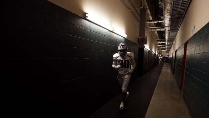 American team safety Andre Kates (30)of Virginia Union runs through the tunnel to the field before the NFLPA Collegiate Bowl on Saturday, Jan. 19, 2013 in Carson, Calif. (Ric Tapia/AP Images for NFLPA)