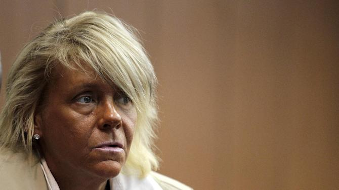 FILE - In this May 2, 2012 file photo, Patricia Krentcil, 44, waits to be arraigned at the Essex County Superior Court in Newark, N.J., where she appeared on charges of endangering her 5-year-old child by taking her into a tanning salon. Krentcil was sent to a detox facility Saturday, June 15, 2013, after allegedly being intoxicated at the Minneapolis-St. Paul International Airport. (AP Photo/Julio Cortez, File)