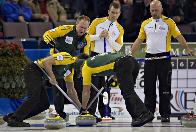 Northern Ontario skip Jacobs watches as teammates E.J. Harnden and Ryan Harnden sweep during play at the Canadian Men's Curling Championships in Edmonton