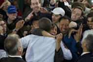 US President Barack Obama greets supporters after speaking during a campaign event in Milwaukee, Wisconsin, September 22, 2012. A week on Tuesday, Mitt Romney will face off against Obama in the first of three televised presidential debates