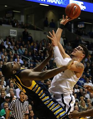 Xavier beats Marquette 86-79 for 8th straight win