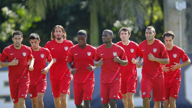 U.S. men's national soccer team members warm up during a workout, Tuesday, Oct. 9, 2012 on the campus of Florida International University in Miami. The U.S. plays at Antigua and Barbuda on Friday Oct. 12, and in Kansas City against Guatemala on Oct. 16, in two World Cup qualifying matches. (AP Photo/Wilfredo Lee)