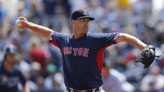 Boston Red Sox pitcher Steven Wright  delivers against the Tampa Bay Rays in the first inning during an exhibition spring training baseball game, Saturday, March 28, 2015, in Port Charlotte, Fla. (AP Photo/Brynn Anderson)