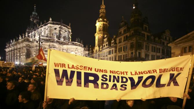 "Participants hold a banner during a demonstration called by anti-immigration group PEGIDA, a German abbreviation for ""Patriotic Europeans against the Islamization of the West"", in Dresden"