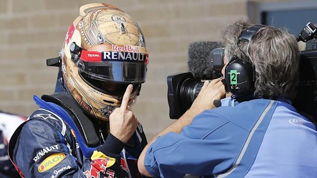 Red Bull Formula One driver Sebastian Vettel of Germany gestures after taking the pole position following the qualifying session of the U.S. F1 Grand Prix at the Circuit of the Americas in Austin, Texas (Reuters)