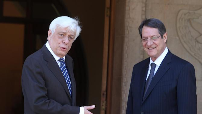 Cyprus' President Nicos Anastasiades, left, and President of Greece, Prokopis Pavlopoulos, talk at the presidential palace following a meeting in capital Nicosia, Cyprus, March 30 , 2015. President of Greece Prokopis Pavlopoulos arrived in Cyprus for a two-day official visit, his first since assuming his duties.(AP Photos/Philippos Christou)