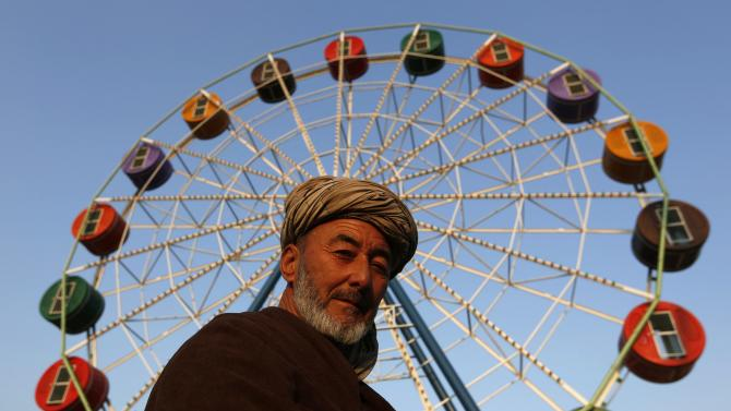 An Afghan man looks on as he visits City Park, the first amusement park in Kabul