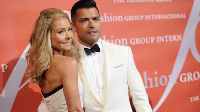 """Television personality Kelly Ripa and her husband Mark Consuelos attend the 29th Annual """"Night Of Stars"""" presented by The Fashion Group International at Cipriani Wall Street on Thursday Oct. 25, 2012 in New York. (Photo by Evan Agostini/Invision/AP)"""