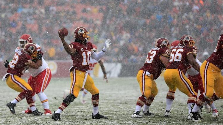 Quarterback Robert Griffin III of the Washington Redskins throws a first quarter pass against the Kansas City Chiefs at FedExField on December 8, 2013 in Landover, Maryland
