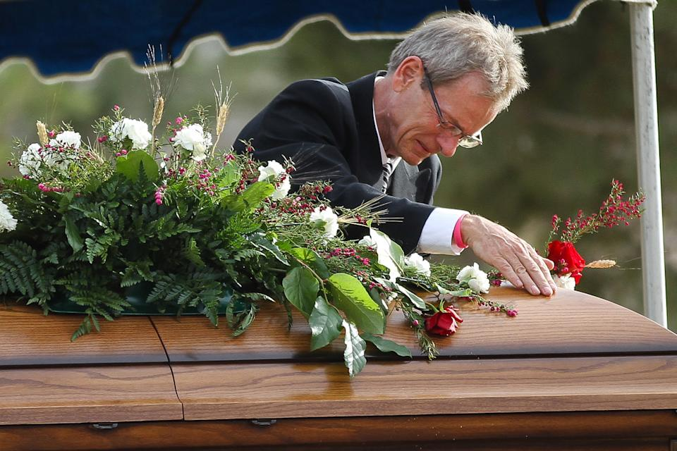 Gary Arnold becomes emotional during a funeral service for his late wife, Sherry Arnold, in Sidney, Mont. on Friday, March 30, 2012. Arnold, a high school teacher, was kidnapped and murdered after disappearing in January. (AP Photo/Williston Herald, Elijah Nouvelage)