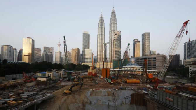A construction site next to the Petronas Towers in Kuala Lumpur