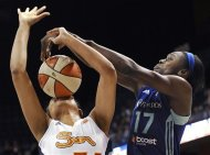 New York Liberty's Essence Carson, right, fouls Connecticut Sun's Chay Shegog during the second half of a WNBA basketball game in Uncasville, Conn., Friday, June 15, 2012. Connecticut won 97-55. (AP Photo/Jessica Hill)