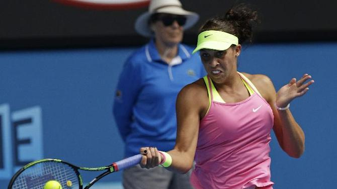 Madison Keys of the U.S. makes a forehand return to her compatriot Serena Williams during their semifinal match at the Australian Open tennis championship in Melbourne, Australia, Thursday, Jan. 29, 2015. (AP Photo/Lee Jin-man)