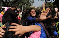 Indian students dance as they take part in a One Billion Rising rally in New Delhi on February 14, 2013. In New Delhi, the site of angry protests just weeks ago after the brutal rape of a student on a bus, campaigners said they would use the day to keep pressure on the government to introduce new measures to protect women