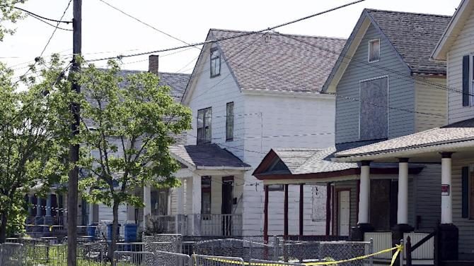 The house is shown where three women were held in Cleveland, Ohio, Thursday, May 9, 2013.  Ariel Castro was charged with four counts of kidnapping and three counts of rape.  Ariel Castro was charged while his brothers, Pedro and Onil Castro, were held but faced no immediate charges.(AP Photo/David Duprey)