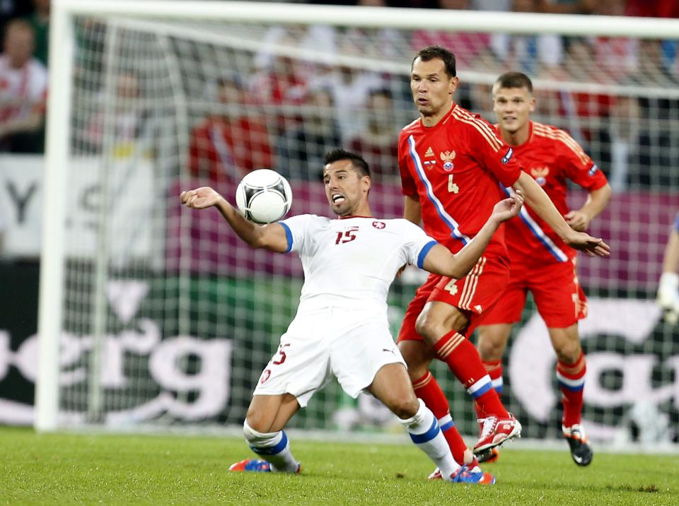 Czech Republic's Milan Baros stops the ball in front of Russia's Sergei Ignashevich during the Euro 2012 soccer championship Group A match between Russia and Czech Republic in Wroclaw, Poland, Friday, June 8, 2012. (AP Photo/Jon Super)