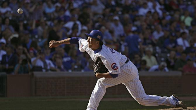 Chicago Cubs relief pitcher Kyuji Fujikawa of Japan, delivers during the seventh inning of a baseball game against the Los Angeles Dodgers, Friday, Sept. 19, 2014, in Chicago. (AP Photo/Charles Rex Arbogast)