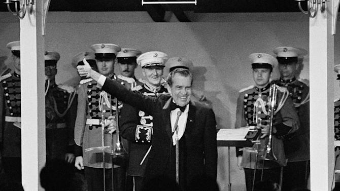 FILE - In this May 24, 1973 file photo, President Richard Nixon gives thumbs up as he addresses about 450 former POWs and their guests at a White House dinner in Washington, DC.   On Thursday, May 24, 2013, some 200 former POWs, almost all of them former pilots, will reunite for a three-day celebration at the Richard Nixon Presidential Library & Museum in Yorba LInda, Calif., that coincides with the 40th anniversary of that star-studded White House dinner hosted by President Nixon to honor their sacrifice.  At the time, Nixon was embroiled in Watergate, but the former prisoners, now in their 60s and 70s, credit him with their freedom and have no qualms about expressing their loyalty for the 37th president. (AP Photo, File)