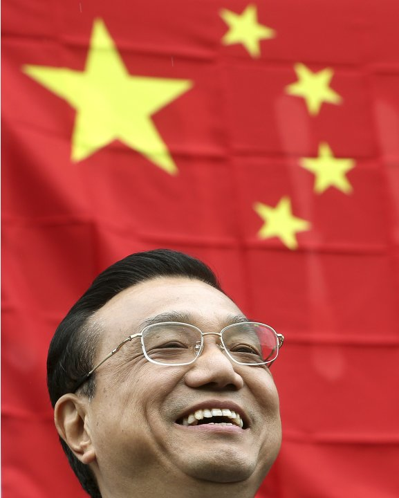 Chinese Premier Li Keqiang smiles during his visit to Guldenberg farm in Embrach