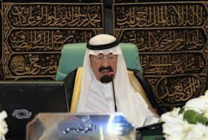 Saudi Arabia's King Abdullah speaks at the opening ceremony of the OIC summit in Mecca