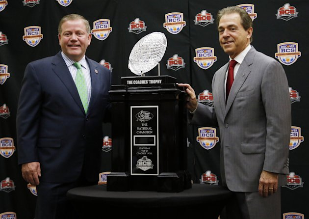Alabama head coach Nick Saban and Notre Dame head coach Brian Kelly pose with The Coaches' Trophy during a news conference for the BCS National Championship college football game Sunday, Jan. 6, 2013,