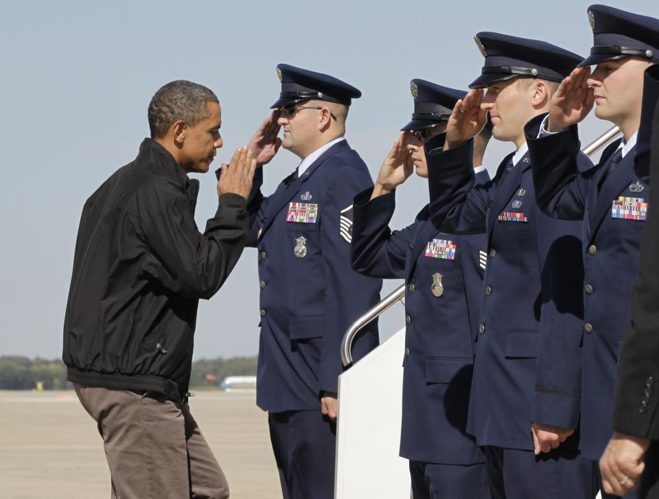 President Barack Obama responds to a salute as he boards Air Force One at Andrews Air Force Base in Maryland outside Washington, Sunday, Oct. 17, 2010. With only two weeks until critical midterm elections, Obama is traveling to Ohio to muster support for Democratic candidates, including Governor Ted Strickland. (AP Photo/J. Scott Applewhite)