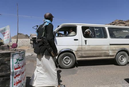 Shi'ite Houthi rebel mans a checkpoint in Yareem town of Yemen's central province of Ibb