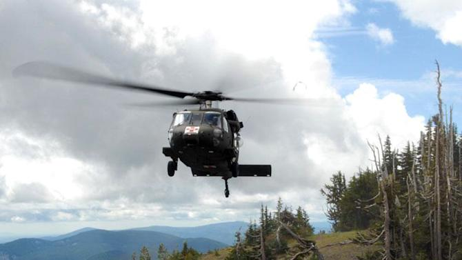 In this photo supplied by the Clackamas County Sheriff's office, an Oregon National Guard Blackhawk helicopter lands at Timberline Lodge near Government Camp, Ore., as the search for a lost climber continues on Mount Hood Thursday, June 27, 2013. Weather cleared up enough to launch an air search for dentist and avid climber Kinley Adams, who has been missing since Saturday. (AP Photo/Clackamas County Sheriff)