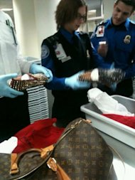 TSA officials examine the potentially dangerous shoes. Photo via @TazArnold