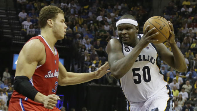 Memphis Grizzlies' Zach Randolph (50) charges past Los Angeles Clippers' Blake Griffin (32) during the second half of Game 3 in a first-round NBA basketball playoff series in Memphis, Tenn., Thursday, April 25, 2013. The Grizzlies defeated the Clippers 94-82. Randolph scored 27 points in the game(AP Photo/Danny Johnston)