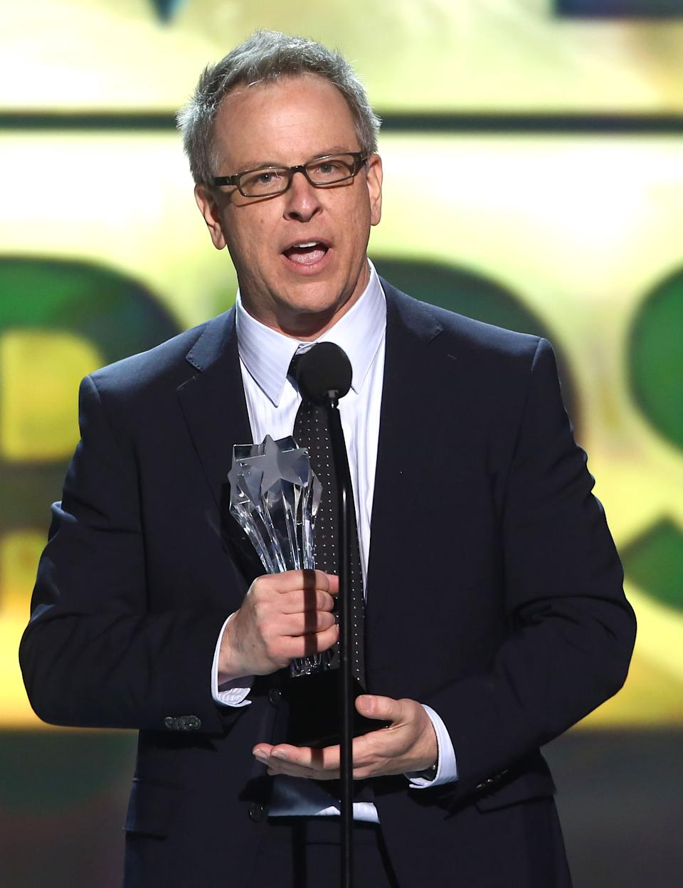 "Rich Moore accepts the award for best animated feature for ""Wreck-It Ralph"" at the 18th Annual Critics' Choice Movie Awards at the Barker Hangar on Thursday, Jan. 10, 2013, in Santa Monica, Calif.  (Photo by Matt Sayles/Invision/AP)"