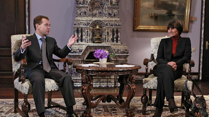 Russian President Dmitry Medvedev, left, gestures while speaking to Swiss President Micheline Calmy-Rey in the Gorki residence outside Moscow, Russia, Sunday, Oct. 30, 2011. Medvedev, who spoke at the meeting with visiting Swiss President Micheline Calmy-Rey, thanked her for Swiss mediation of Russia's WTO accession talks.(AP Photo/RIA-Novosti, Dmitry Astakhov, Presidential Press Service)