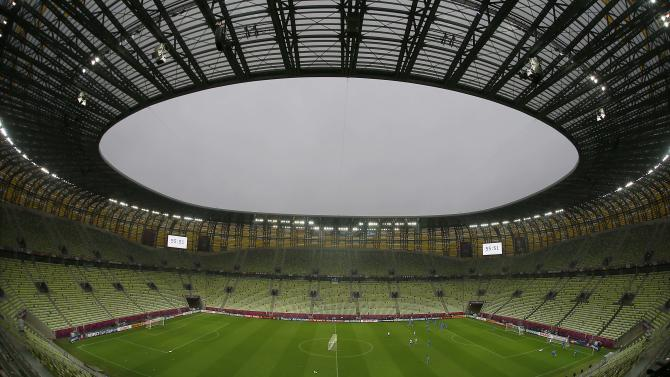 In this photo taken with a fisheye lens, a general view of the Gdansk stadium during a training session by the Greek national soccer team prior to the Euro 2012 soccer quarterfinal match between Germany and Greece in Gdansk, Poland, Thursday, June 21, 2012. (AP Photo/Frank Augstein)