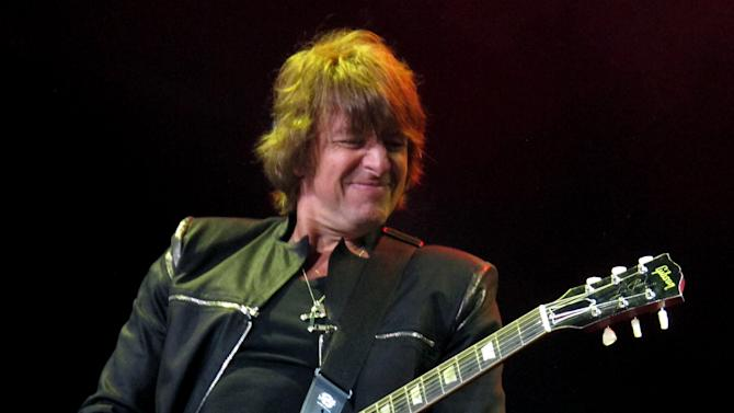 "FILE - This May 20, 2012 file photo shows Bon Jovi guitarist Richie Sambora performing at the Bamboozle Festival in Asbury Park N.J. Sambora's solo release ""Aftermath of Lowdown"" covers a lot of personal ground for the rocker including his much-publicized divorce from Heather Locklear, his ongoing battle with alcohol and substance abuse, and the virtues of being a parent.  (AP Photo/Wayne Parry, file)"