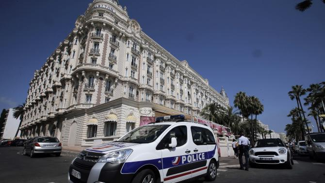 "A view of the Carlton hotel, in Cannes, southern France, the scene of a daylight raid, Sunday July 28, 2013. A staggering 40 million euro ($53 million) worth of jewels and diamonds were stolen Sunday from the Carlton Intercontinental Hotel in Cannes, in one of Europe's biggest jewelry heists recent years, police said. French police say a luxury watch store has been robbed on the same exclusive promenade in Cannes, Wednesday July 31, 2013. A Cannes police union representative, says two armed men, their faces concealed by scarves and caps, made off with a ""significant"" haul of luxury watches during the robbery at Kronometry, less than a half mile from the Carlton Intercontinental Hotel where a single gunman stole the jewels on Sunday. (AP Photo/Lionel Cironneau)"