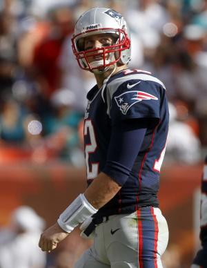 New England Patriots quarterback Tom Brady (12) leaves the field during the second half of an NFL football game against the Miami Dolphins, Sunday, Dec. 2, 2012, in Miami . (AP Photo/John Bazemore)