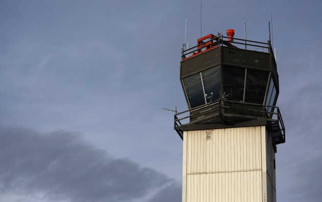 The air traffic control tower is seen at the Ogden-Hinckley Airport in Ogden, Utah, in this March 11, 2013 file photo. When landing a plane amid birds, bobcats or alligators, it helps to have an air traffic controller on the lookout. But many small airports across the United States face losing this extra pair of eyes starting April 1, as budget cuts at the Federal Aviation Administration threaten closure of 189 air traffic control towers. REUTERS/Jim Urquhart/Files  (UNITED STATES - Tags: TRANSPORT BUSINESS EMPLOYMENT POLITICS)