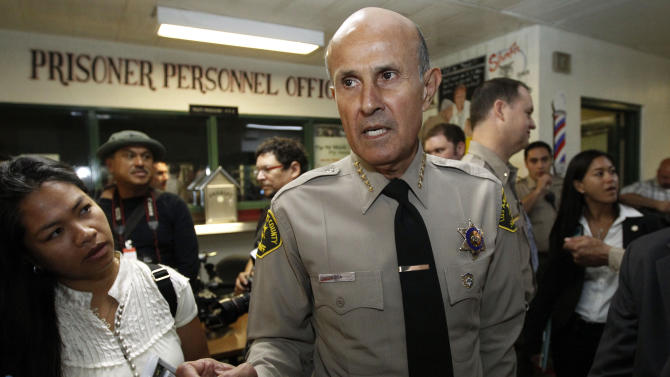 FILE - In an Oct. 3, 2012 file photo, Los Angeles County Sheriff Lee Baca, who supervises the largest jail system in the nation, talks to reporters at the Men's Central Jail in downtown Los Angeles. A law enforcement official says the embattled sheriff will announce his retirement Tuesday, Jan. 7, 2014. (AP Photo/Reed Saxon, File)