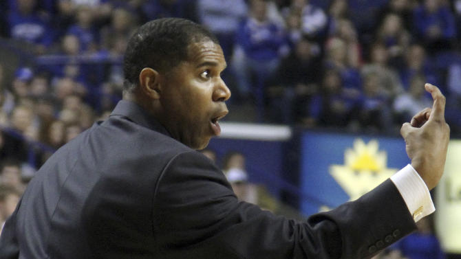 Morehead State coach Sean Woods, a former Kentucky player, gestures to one of his players during the first half of an NCAA college basketball game against Kentucky in Lexington, Ky., Wednesday, Nov. 21, 2012. Kentucky won 81-70. (AP Photo/James Crisp)