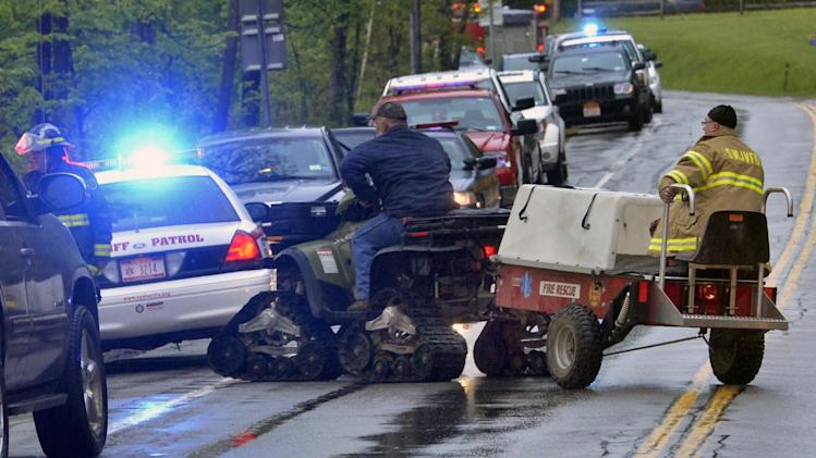 In this Friday, May 24, 2013 photo, rescue workers move a tracked ATV that is towing a recovery sled to the site of a plane crash in a wooded area off Route 10 in the town of Fulton in Ephratah, N.Y., after a small plane crashed killing two people. (AP Photo/The Daily Gazette, Peter R. Barber)  TROY, SCHENECTADY; SARATOGA SPRINGS; ALBANY AND AMSTERDAM OUT