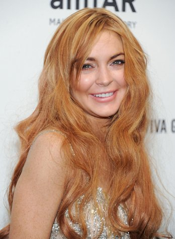 FILE - In this Feb. 6, 2013 file photo, Lindsay Lohan attends amfAR&#39;s New York gala at Cipriani Wall Street in New York. Lohan is due back in court on Monday March 18, 2013 for a hearing that will lay out when her trial will begin on misdemeanor charges she lied to police and was driving recklessly when her sports car crashed in June 2012. Lohan&#39;s trial is scheduled to begin this week, but her attorney has previously sought a delay. (Photo by Evan Agostini/Invision/AP, File)