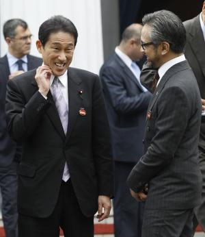 Indonesian Foreign Minister Marty Natalegawa, right, talks with his Japanese counterpart Fumio Kishida during the 2nd Conference on Cooperation among East Asian Countries for Palestinian Development (CEAPAD) in Jakarta, Indonesia, Saturday, March 1, 2014. (AP Photo/Achmad Ibrahim)