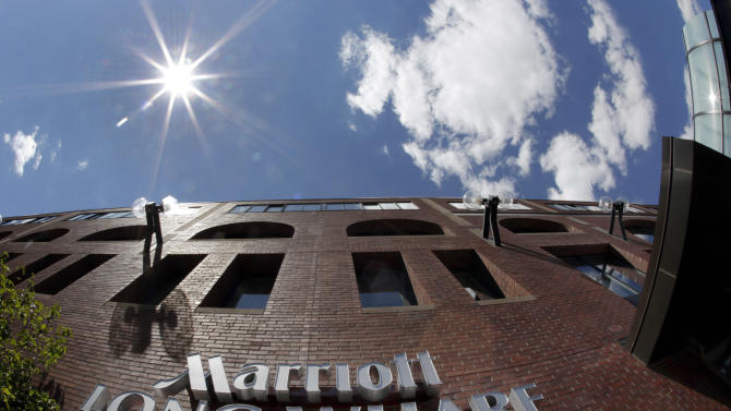 This Monday, July 9, 2012, photo taken with a fish-eye lens shows the exterior of the Marriott Long Wharf in Boston. Marriott says Wednesday, Oct. 3, 2012, it turned a bigger-than-expected profit in the third quarter on higher prices and strong occupancy rates.The company, based in Bethesda, Md., earned $143 million, or 44 cents per share, compared with a loss of $179 million, or 52 cents per share, a year ago. The 2011 quarter was hit by charges related to the spin-off of its time share business. Without those, it earned $104 million or 29 cents per share last year. (AP Photo/Elise Amendola)