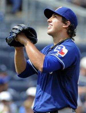 Holland, Rangers tame Yankees, finish strong trip
