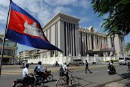 "Traffic rides past the front of the Peace Palace in central Phnom Penh in July 2012. Radio Free Asia has accused the Cambodian government of intimidation after officials summoned the station and fellow US-funded broadcaster Voice of America to discuss their ""professionalism"""
