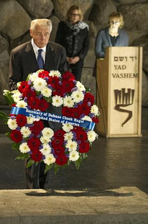US Secretary of Defense Chuck Hagel, front,  places a wreath at the Hall of Remembrance as he tours Yad Vashem in Jerusalem, on April 21, 2013. (AP PhotoJim Watson, Pool)