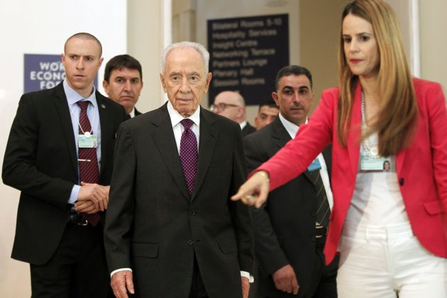 Israeli President Peres walks to speak to the media during the World Economic Forum on the Middle East and North Africa at the Dead Sea